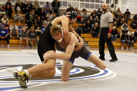 Carlsbad's Mason Box spears Hobbs' Zaid Ayala in their 152-pound match on Feb. 6, 2020. Box recorded a pinfall victory and Carlsbad won, 62-15.