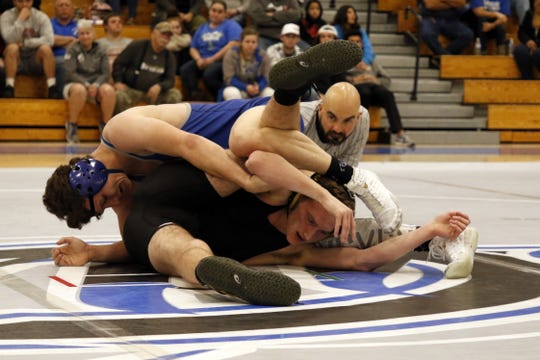 Carlsbad's Justin Wood (top) works on pinning Hobbs' Anson Smith in their 160-pound match on Feb. 6, 2020. Wood recorded a pinfall victory and Carlsbad won, 62-15.