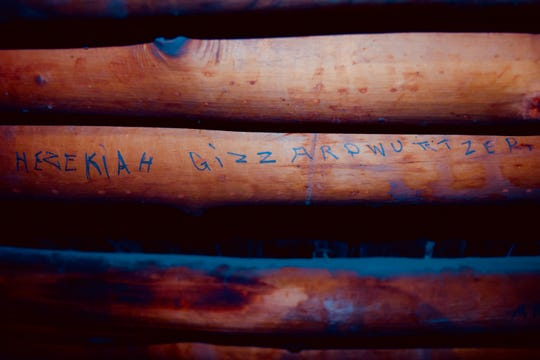The name Hezekiah Gizzardwurtzer is scrawled on a viga at what is now Aztec Ruins National Monument, adding some levity to a survey of historic inscriptions at the site.