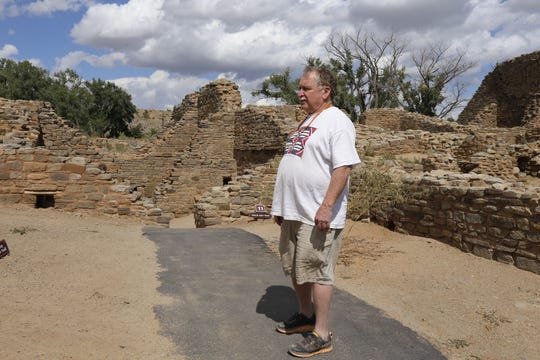 Fred Blackburn stands outside the West Ruin at Aztec Ruins National Monument in September 2019 while conducting a survey of historic inscriptions at the site.