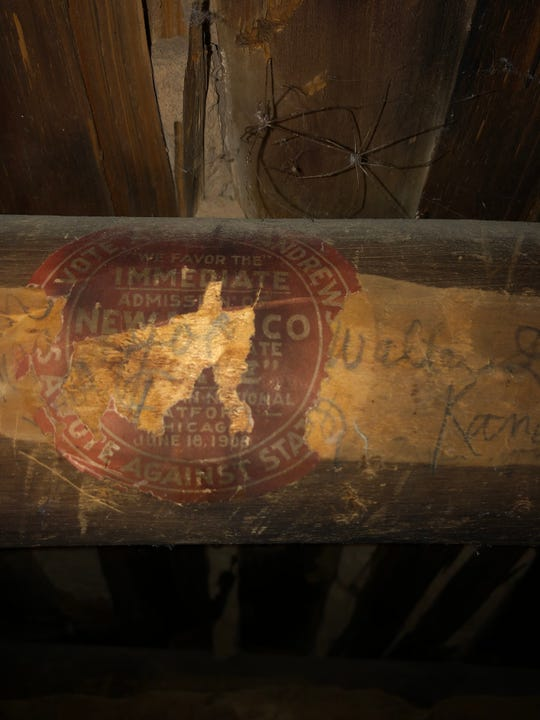 The remnants of a sticker attached to a viga at what is now Aztec Ruins National Monument offer evidence of an active socialist movement in the area in the early 1900s, Fred Blackburn says.