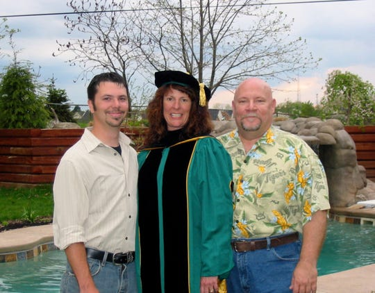 Graham E. Smith stands with his parents Katherine and Ken Massey of Farmington Hills. Smith fatally shot himself in 2011. His parents frequently share their story, trying to fight the stigma of suicide.