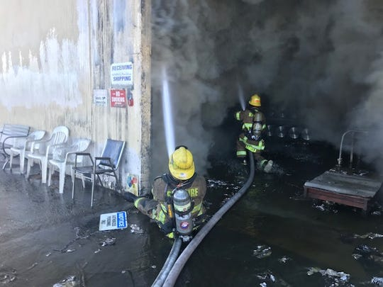 Firefighters battle a blaze at Apollo Records on Thursday, Feb. 6, in Banning.