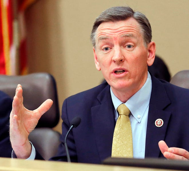 "FILE - In this Dec. 2013, file photo, U.S. Rep. Paul Gosar, R-Ariz., speaks during a Congressional field hearing on the Affordable Care Act in Apache Junction, Ariz. Gosar appears to be signaling support for a conspiracy theory that Jeffrey Epstein did not kill himself while awaiting trial on sex trafficking charges. The Republican congressman sent 23 tweets Wednesday, Nov. 13, 2019 about impeachment hearings. The first letter of each tweet spelled out would read, ""Epstein didn't kill himself."" (AP Photo/Matt York, File)"