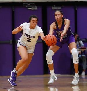 Millennium's Jasmine Singleton (2) steals the ball away from Valley Vista's Mikela Cooper (22) during the first half at Millennium High School in Goodyear, Ariz. on Feb. 6, 2020.