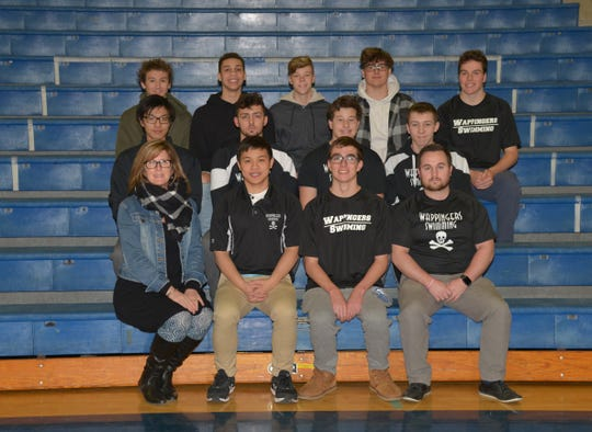 The Wappingers boys swimming team poses alongside coach Renay Cerrato.
