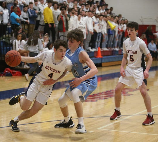 Ketcham's Brendan Cassidy drives against a John Jay defender during a Feb. 6 boys basketball game.