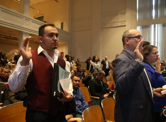 Hector DeLeon takes the Oath of Allegiance during Friday's naturalization ceremony at the Family Partnership Center in the City of Poughkeepsie on February 07, 2020.