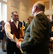 Hector DeLeon receives his naturalization certificate from Dutchess County Clerk Bradford Kendall during Friday's naturalization ceremony at the Family Partnership Center in the City of Poughkeepsie on February 07, 2020.