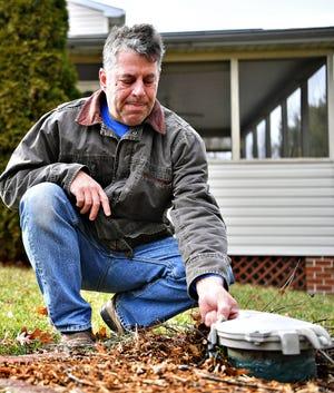 Randy Engle is shown next to the well that rests on his property at his home in Shrewsbury Township, Friday, Feb. 7, 2020. Dawn J. Sagert photo