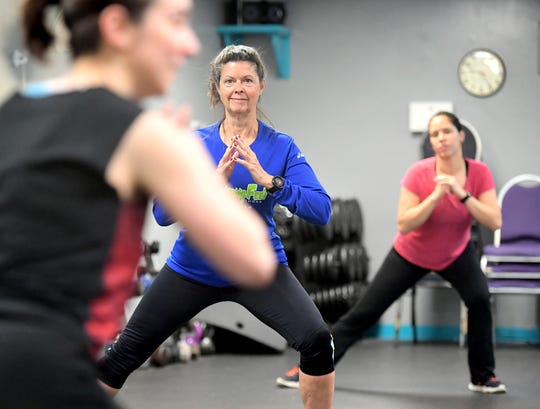 Karen Mitchell of Manchester and Anita Gonseca of Shiloh, right, participate in a a cardio class led by Allison Galbreath at the Bob Hoffman YMCA in Dover Friday, Feb. 7, 2020. The facility is slated for building renovations. Bill Kalina photo