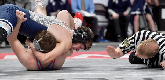 Dallastown's Andrew Smith pints Zachary Bayer of Father Judge to win the 195 pound bout of the PIAA Class 3-A first-round wrestling tournament, Thursday, February 6, 2020.