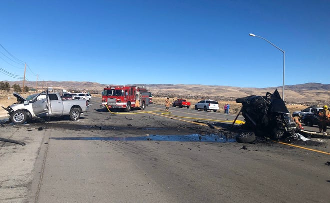 Crews respond to a head-on crash that left two drivers critically injured and forced authorities to close Pyramid Highway in both directions on Friday, Feb. 7, 2020, in Spanish Springs.