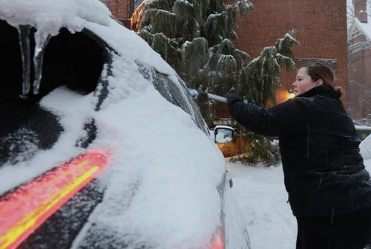 Ashley Potter of Rochester scrapes ice off her car before heading to work. Ice has covered much of the area causing many Monroe County schools to close on Feb. 7, 2020.