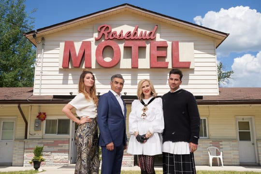 The Rose family in front of the motel they call home in the show Schitt's Creek.