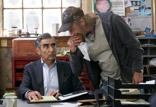 Showrunner Eugene Levy, at left, also plays patriarch Johnny Rose in the series. In this screen capture from an episode of Schitt's Creek, Johnny Rose reacts to zany Schitt's Creek Mayor Roland Schitt.