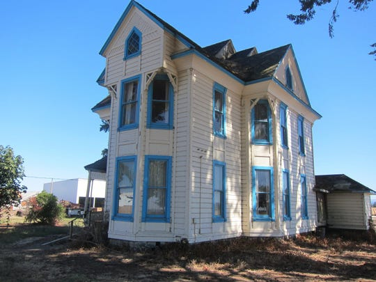A photo shows the Wiesner Farm House before the family sold it in 2011.