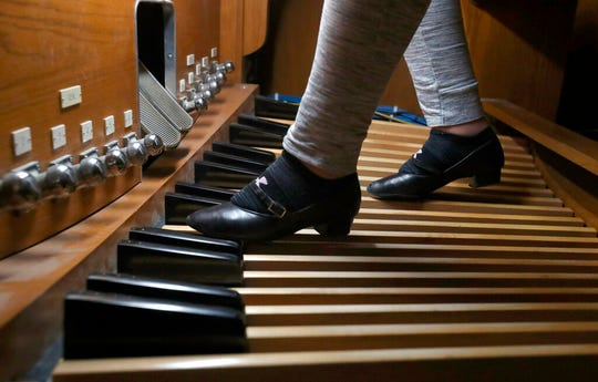 ADVANCE FOR PUBLICATION ON SATURDAY, FEB. 8, AND THEREAFTER - In a Jan. 28, 2020, photo, Ella Kempf steps on the foot pedals as she plays a piece on the organ at Zion Lutheran Church, in Aberdeen, S.D. Ella's grandmother, music mentor Sonya Kempf, has played at Zion Lutheran for 50 years.