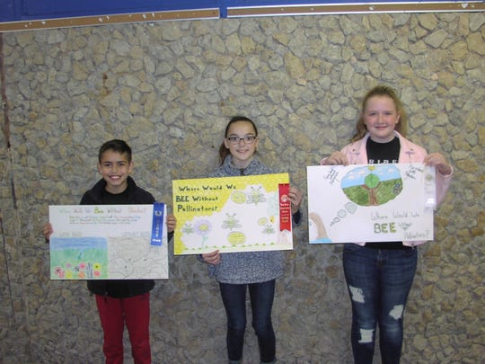 Veribest Elementary School fifth-grade conservation poster contest winners are, from left, Braden Hierro, first place, Emmalee Pfluger, second place; Kenzie Gilly, third; All three students are in Mrs Janet Phinney, 5th grade class (not shown).