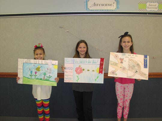 Water Valley Elementary School Fourth Grade Conservation Poster Contest Winners are, from right, Aleya Levens, first place; Peyton Schiff, second; Gloria Gomez, third. All three students are in Mrs Melissa Glass 4th grade class (not shown).