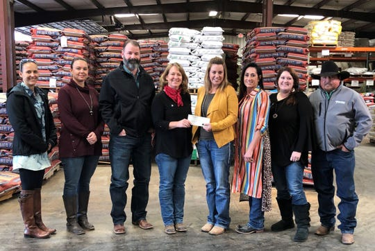 """Representatives from Palmer Feed in San Angelo recently presented donations for more than $1,170 to Sonrisas Therapeutic Riding with proceeds from their annual """"Sack It"""" program."""