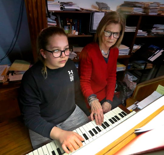 In a Jan. 28, 2020, photo, Sonya Kempf, right, helps her granddaughter Ella during a lesson on the organ at Zion Lutheran Church, in Aberdeen, S.D. Music mentor Kempf has played at Zion Lutheran for 50 years.