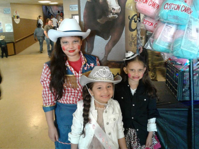 Isabel (left), Ileana (right) and Izara Garcia-Ramos (center) at the 2019 San Angelo Rodeo.