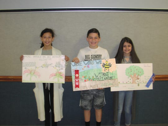 Water Valley Elementary School Fifth Grade Conservation Poster Contest Winners are, from right, Macee Mae Sims, first place; Branson Lacy, second; Miricle McKinney, third.  All three students are in Mrs Megan Doss, 5th grade class (not shown).