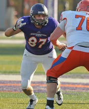 Northwestern State's Wade Williams (87) takes on a blocker from Sam Houston State.