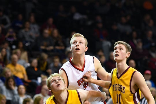 Matthew Mors of Yankton and Nick Tschudy and Sam Christensen of Harrisburg watch a free throw go into the basket during the Throwback Classic on Thursday, Feb. 6, at the Sanford Pentagon in Sioux Falls.