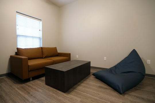 "The living room in an unoccupied apartment at the Leonard Apartments, a new apartment complex that serves as an ""intermediate step"" for young people who are aging out of foster care."