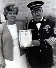 Walter B. Dixon, right, poses with his wife.