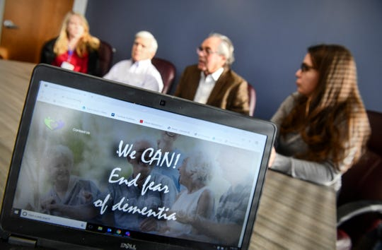 Central Minnesota Dementia Community Action Network leaders speak as an image of the group's web site is displayed during an interview Tuesday, Feb. 4, 2020, in St. Cloud.