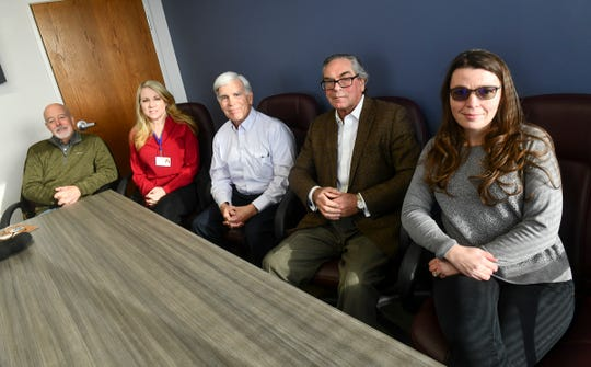 Central Minnesota Dementia Community Action Network founders, from left to right, Steve Hoover, Tami Kolbinger, Dr. Patrick Zook , Rick Tanler and Cristina Rodriguez are pictured Tuesday, Feb. 4, 2020, in St. Cloud.