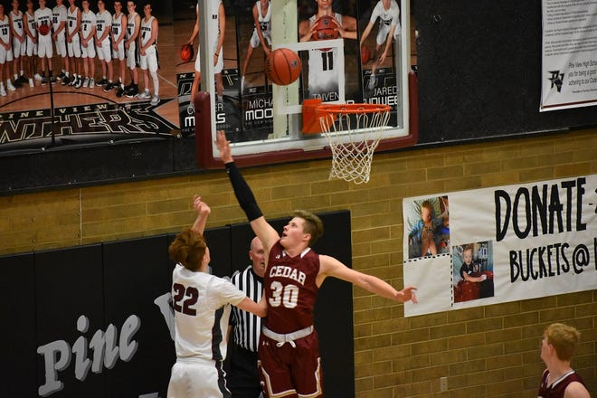 Cedar's Landon Barney attempts to block a shot during the Reds' win over Pine View