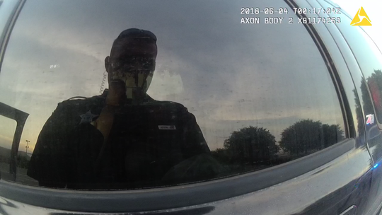 Former Jackson County Deputy Zachary Wester's reflection seen on his body camera footage.