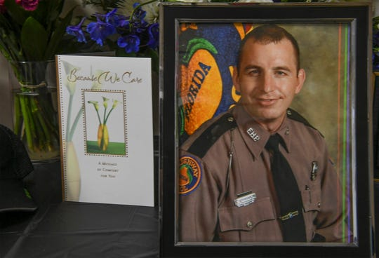 A memorial for FHP Trooper Joseph Bullock is seen inside the lobby of the FHP Troop L Fort Pierce district building on Friday, Feb. 7, 2020, in Fort Pierce.