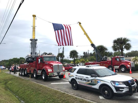 Onlookers gather to honor FHP Trooper Joseph Bullock as his body is transported from Fort Pierce to Sarasota Feb. 7, 2020.