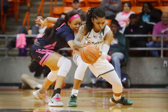 UTEP's Ariona Gill goes against Charlotte's Jade Phillips during the game Thursday, Feb. 6, at the Don Haskins Center in El Paso.