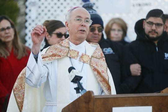 Bishop Mark Seitz holds a prayer vigil to distribute rosaries to  family members of the Aug. 3, 2019 Walmart shooting given to him by Pope Francis Thursday, Feb. 6, at the Catholic Diocese of El Paso. Pope Francis gave 50 rosaries to Bishop Seitz to distribute.