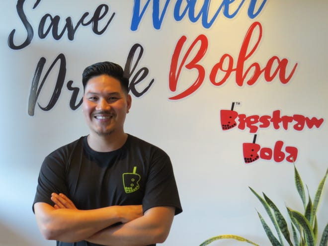 Richard Tran, owner of Bigstraw Boba in Ventura, made a point of giving patrons several Instagram-ready backgrounds from which to choose at the newly opened shop.