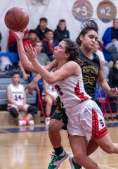 Strathmore's Jazmin Soto drives through Sierra Pacific's Savvy Torres in an East Sequoia League girls high school basketball game on Thursday, February 6, 2020. Soto, a junior, surpassed 2,000 career points last month.