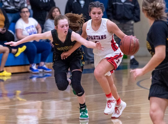 Sierra Pacific's Kylie Brasil, left, pressures Strathmore's Jazmin Soto in an East Sequoia League girls high school basketball game on Thursday, February 6, 2020. Soto, a junior, surpassed 2,000 career points last month.