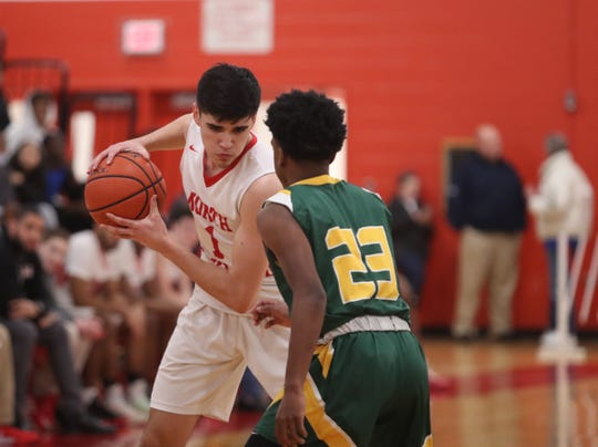 Ramapo's Bryan Felix (23) defends North Rockland's Matt Konicoff (1) during their 63-52 loss to North Rockland in boys basketball action at North Rockland High School in Thiells on Thursday, February 6, 2020.