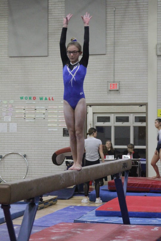 Suffern 7th-grader Ava Greenhut in action during the Section 1 Gymnastics Championships.