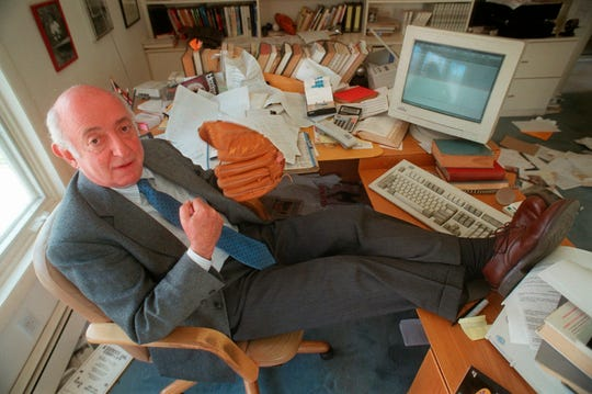 """Author Roger Kahn, author of the bestseller """"The Boys of Summer"""", poses at his home in Croton-on-Hudson, New York, in this April 25, 1997, file photo.  Kahn, the writer who wove memoir and baseball and touched millions of readers through his romantic account of the Brooklyn Dodgers died Thursday, Feb. 6, 2020, at a nursing facility in Mamaroneck, New York, according to his son Gordon Kahn. He was 92."""