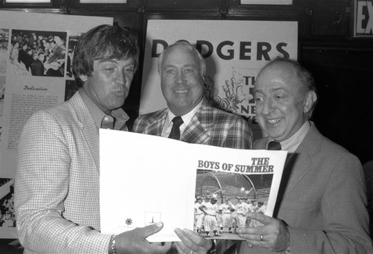 """In this June 24, 1982, file photo, author Roger Kahn, right, joins former Brooklyn Dodger outfielder Duke Snider, center, and former Dodger pitcher, Clem Labine, at the start of production on the television film based on Kahn's best selling book, """"The Boys of Summer,"""" in New York. Kahn, the writer who wove memoir and baseball and touched millions of readers through his romantic account of the Brooklyn Dodgers died Thursday, Feb. 6, 2020, at a nursing facility in Mamaroneck, New York, according to his son Gordon Kahn. He was 92."""