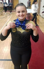 Lakeland/Panas/Putnam Valley's Caitlin Pellegrino shows off the four medals she won at the Section 1 Gymnastics Championship meet at Anne M. Dorner Middle School in Ossining on Feb. 6, 2020.