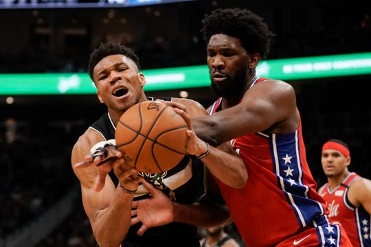 Milwaukee Bucks' Giannis Antetokounmpo is fouled by Philadelphia 76ers' Joel Embiid during the second half of an NBA basketball game Thursday, Feb. 6, 2020, in Milwaukee. The Bucks won 112-101. (AP Photo/Morry Gash)