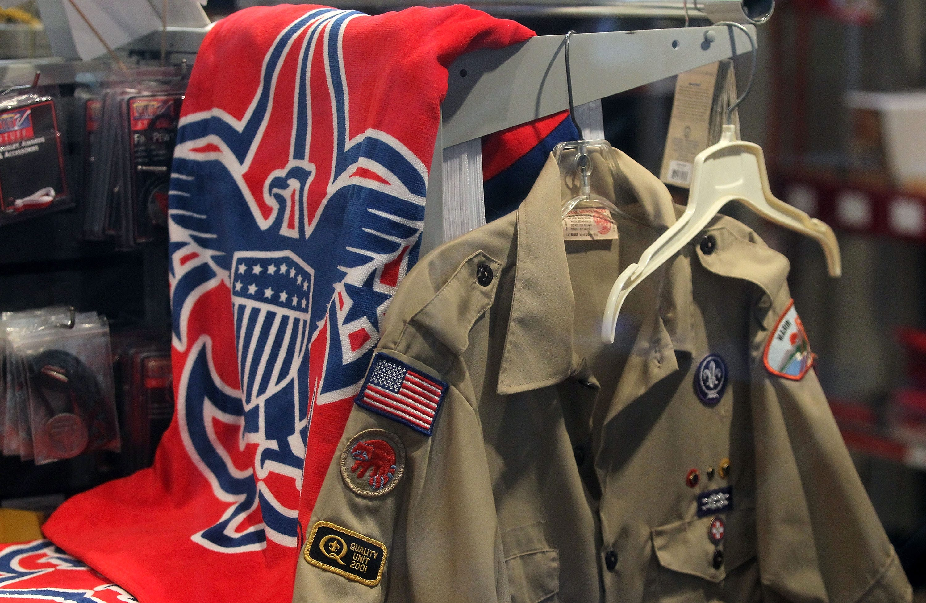 The Boy Scout logo and a uniform are displayed in a store at the Marin Council in Northern California. The scouting movement first made its way to the United States in 1909.